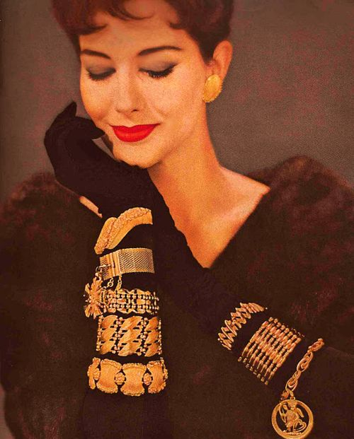 Monet Jewelry, 1950s.    Accessory Tip: Wear bracelets over gloves this winter, to add a vintage accent to an otherwise clunky necessity