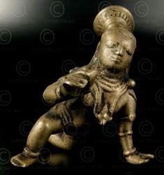Bala Krishna  Bronze statue of crawling Balagopal (infant Krishna), holding a butter ball. Andhra Pradesh, India. 17-18th century.