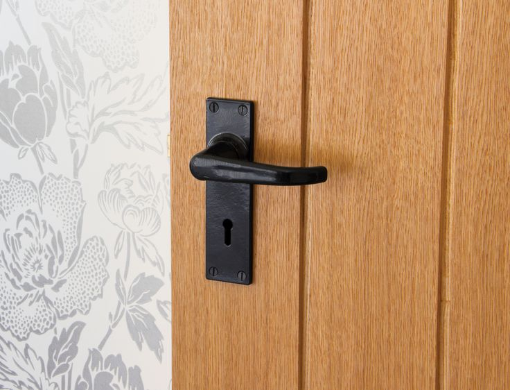 A Brand New Handle On An Oak Door With Stunning Wallpaper From