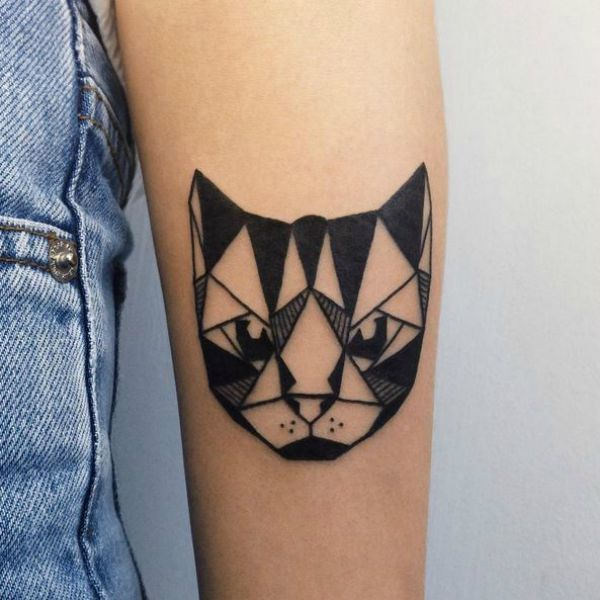 This geometric cat tattoo is a masterpiece.
