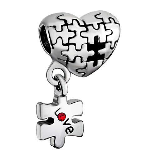 I really like this heart charm!  It looks like a jigsaw puzzle and the missing piece has the word love on it.