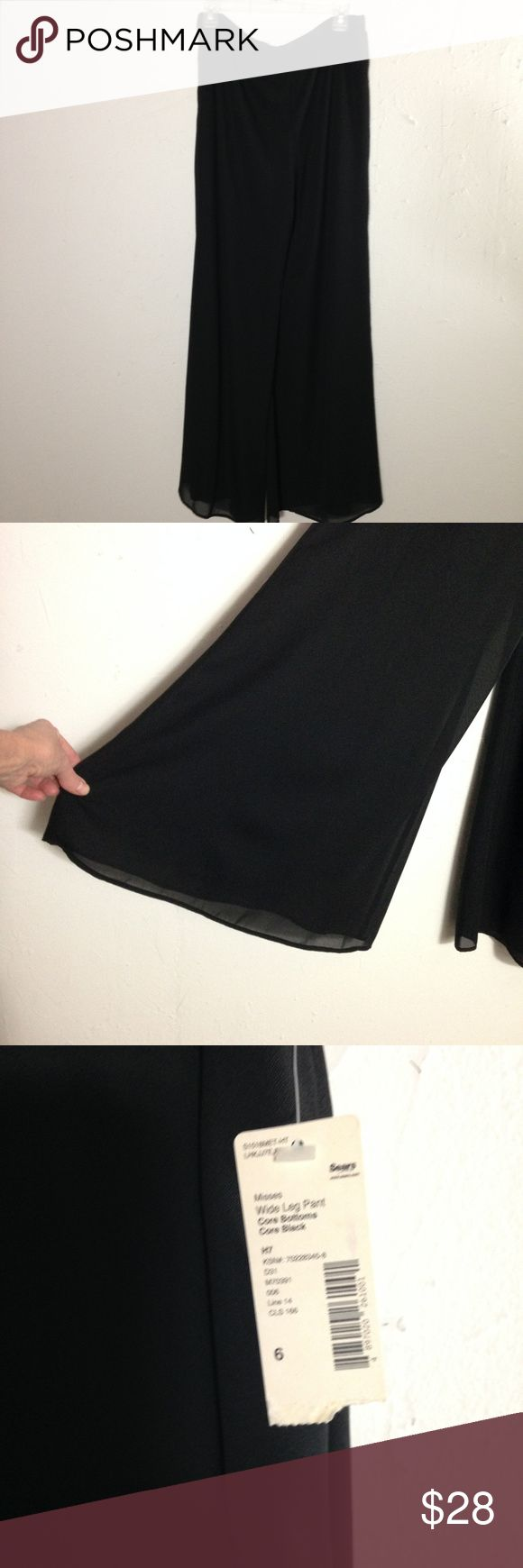 NWT black chiffon palazzo pants for evening. Metaphor black polyester pants with a chiffon overlay. Side zip with elastic back waist band. Measure 32 inches from waist to hem and the leg width is 22 inches seam to seam. Metaphor Pants Wide Leg