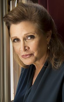 Carrie Frances Fisher (October 21, 1956 – December 27, 2016) was an American actress, screenwriter, author, producer, & speaker. She was known for playing Princess Leia in the Star Wars films. Her other film roles included Shampoo (1975), The Blues Brothers (1980), Hannah & Her Sisters (1986), The 'Burbs (1989), & When Harry Met Sally... (1989). Fisher was born in Beverly Hills, California, the daughter of singer Eddie Fisher & actress Debbie Reynolds.