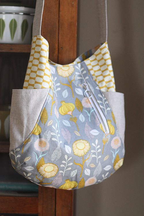 This tote is a fabric lovers favorite! Using small cuts of fabric, you'll be able to use your favorites and still have scraps leftover. It's called the 241 because it's like 2 patterns in one! One version of the bag has two exterior side pockets (great for beginners), the other has two exterior zippered pockets …