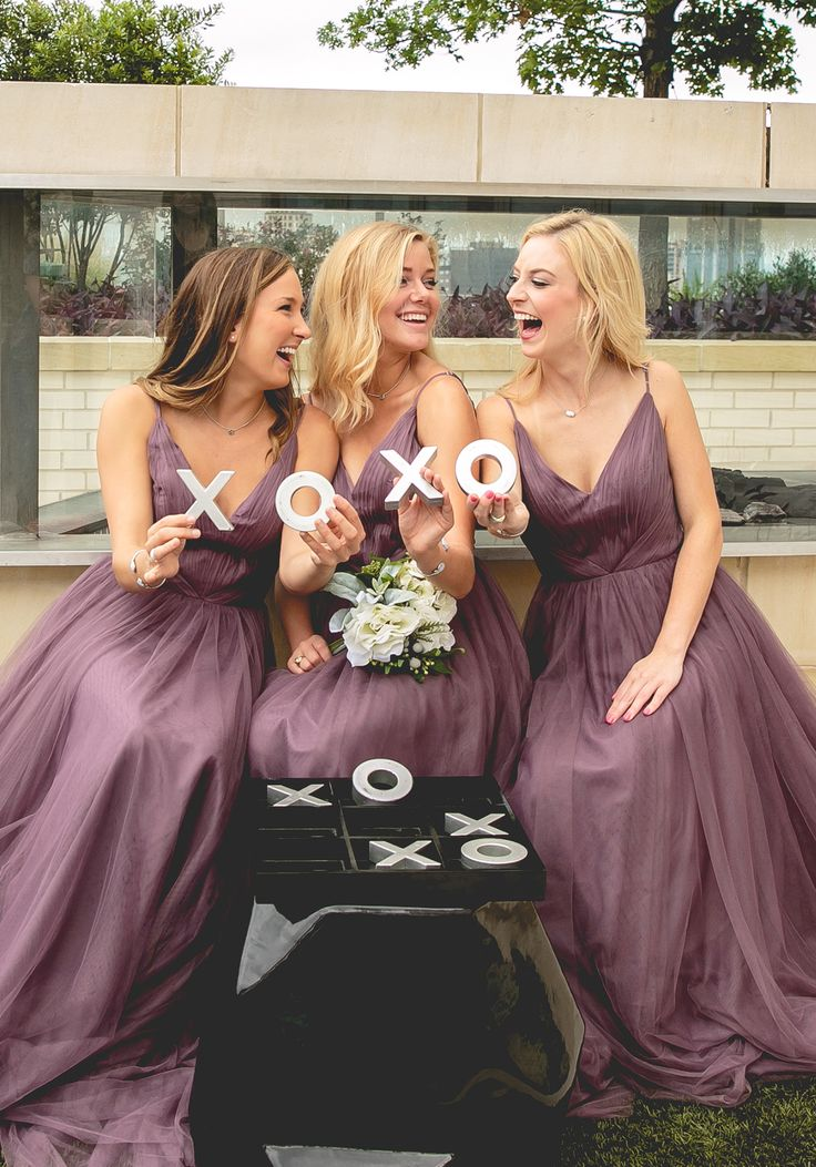 In love with the femininity of these dark purple v neck bridesmaid dresses from @shoprevelry