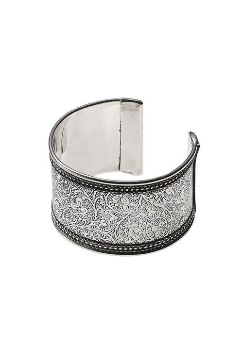 This beautiful white gold cuff is engraved with a delicate ethic floral and vine design, finished with braided edging. This elegant bangle is great for dressing up a work wear blazer and also an ideal smart dress companion.