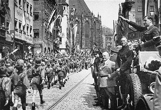 Baldur von Shirach and Hiterjugend marching in Nuremberg  www.HolocaustResearchProject.org