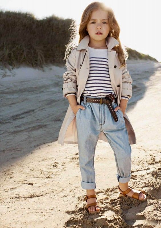 What a little woman! Trent coat. Striped shirt. Rolled Jeans and brown leather belt. Tan leather strappy sandals. She is adorable!