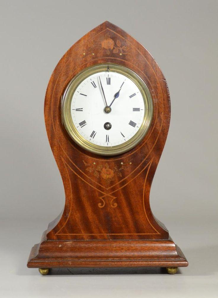 Inlaid mahogany French kidney shaped mantle clock