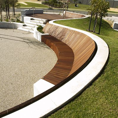 This contemporary curved bench seat in the landscape is so smart. Can you…