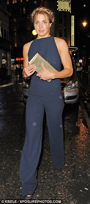 Wet weather: Hollyoaks beauty Gemma Atkinson looked unfazed by the drab weather as she cut...