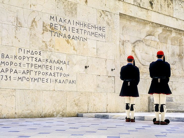 Wooden shoes with pom-poms are part of the traditional dress for guards at the Tomb of the Unknown Soldier in Athens's Syntagma Square. See the photo in Athens's » Photograph by Lucas Vallecillos, VWPics/Redux