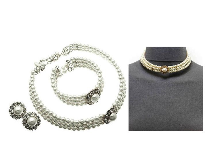 Vintage-style set of choker necklace with bracelet and earrings. Features faux pearls and diamante crystal. £45.00
