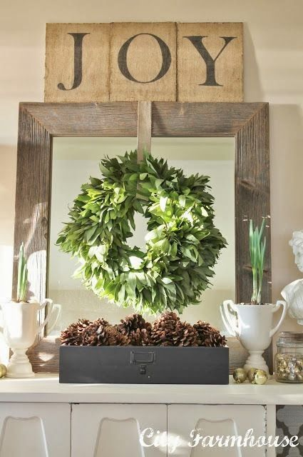 wreath over mirror, creamy white with dark grey and weathered wood.  Great combo