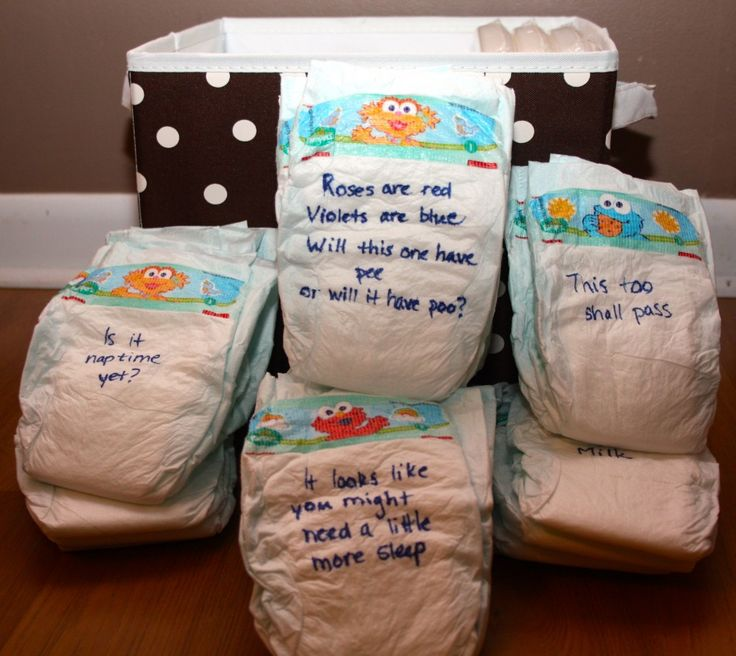 Baby Shower Game: Midnight Diapers (It may be a good idea to write it on index cards that go inside the diaper, so there is no issue with the sharpie bleeding into the diaper)