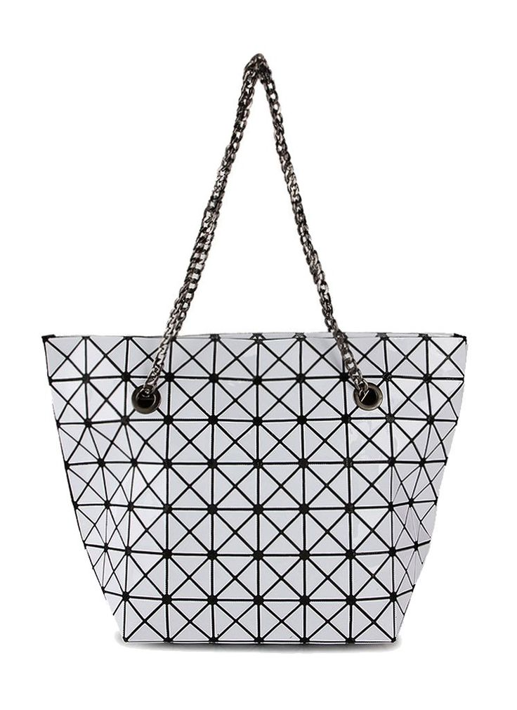 Looking for a new bag? Triangle Tiles Tote by TIVOLI is the answer. Triangle tiles Tote made from synthetic leather, white color triangle with black based made this bag look so eye catching. One main compartment with inner pocket, double handle.    http://www.zocko.com/z/JGjC0