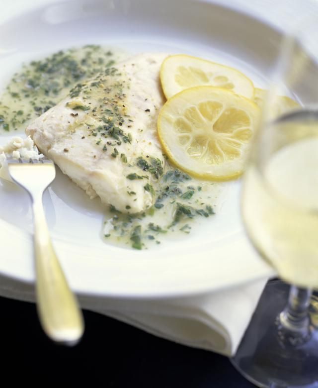 This creamy herb sauce can be served with fish and seafood dishes. It's made by adding fresh herbs to a basic White Wine Sauce.