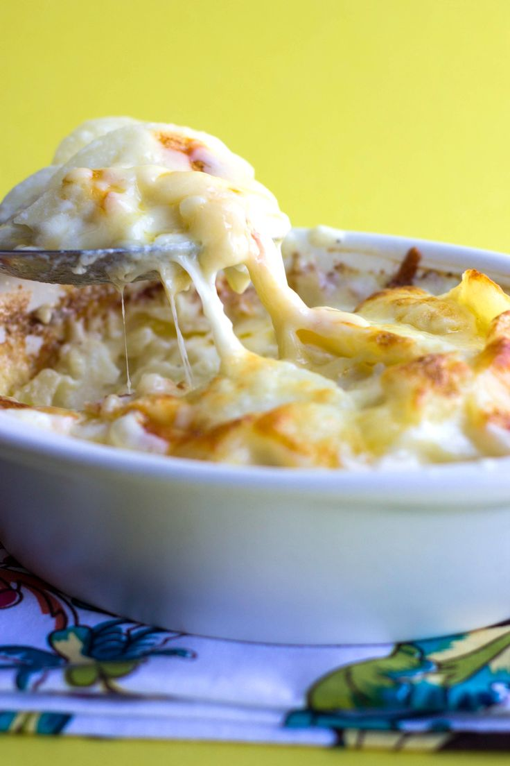 Cheesy Scalloped Potatoes - Erren's Kitchen - Could there be a better way to serve anything than than covered with a creamy sauce and cheese?  This recipe for Cheesy Scalloped Potatoes is comfort food at it's finest!
