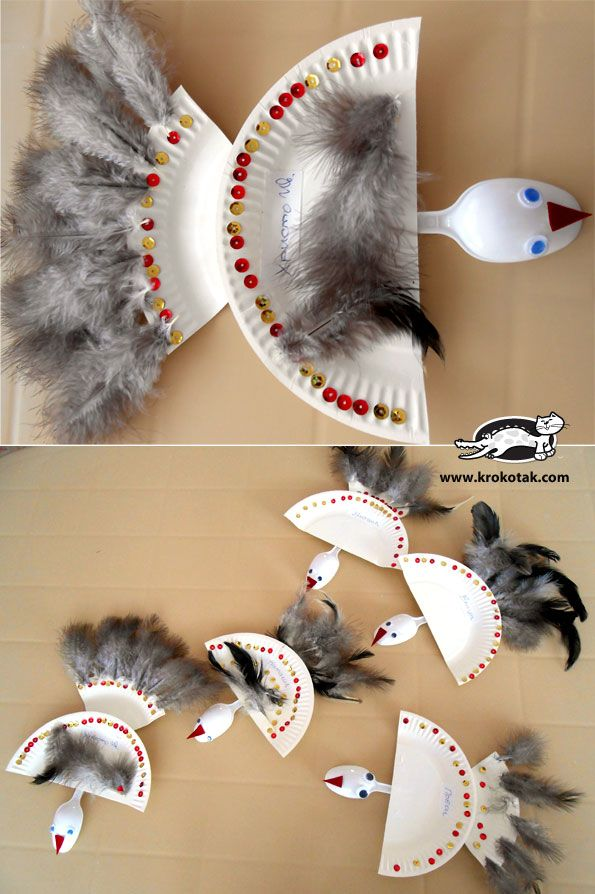 Paper plate bird craft for kids using plastic spoons and feathers