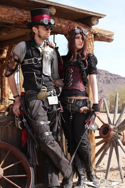 Steampunk Couple in Red and Black (weird west theme, at wild wild west fest in tuscon) - For costume tutorials, clothing guide, fashion inspiration photo gallery, calendar of Steampunk events, & more, visit SteampunkFashionGuide.com