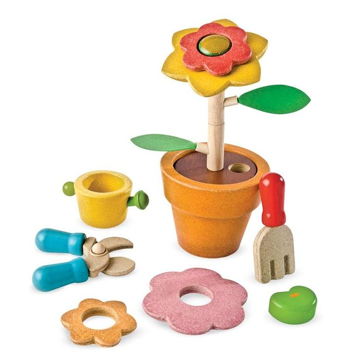 Build-a-Flower Set by Plan Toys  Brooke would love playing with this on the porch next to Papa when they are outside together
