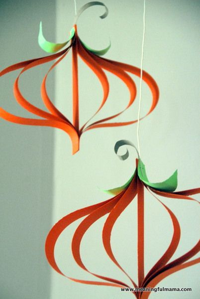 Meaningful Mama: Day #276 - Paper Pumpkin Craft Tutorial, cut orange strips of paper in differing links, arrange smallest to largest, staple; could do with Christmas ornaments, too ;@)