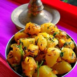 Jeera aloo - a classic Indian recipe of potatoes tempered with cumin seeds and Indian spices.