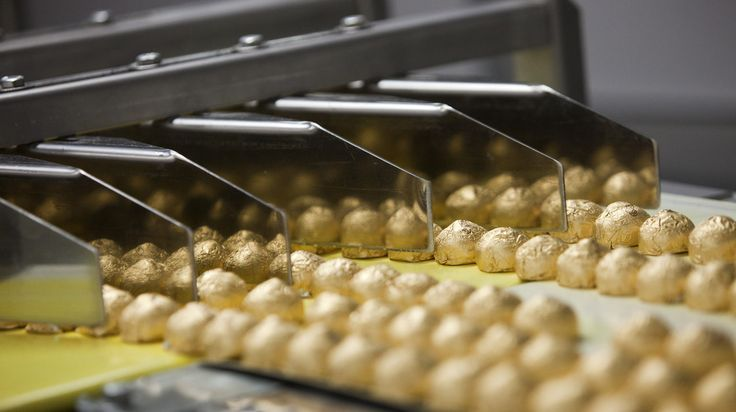 Individually wrapped chocolate-covered hazelnut sweets move along a conveyor belt on the production line at the Roshen Confectionary Corp. f...