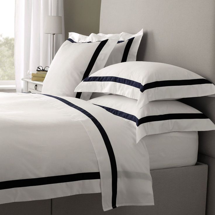 Bed Linen.  Great graphic design with the addition of grosgrain ribbon