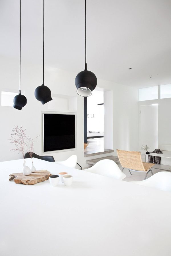 Look at this simple and clean black and white living room from norm architects i love how the magazine rack gets all the attention as its the only