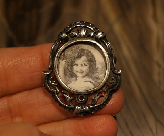 Vintage Sterling Silver Photo Brooch with Art Nouveau Design. Filigree silver with a heavy patina with a scrolling design is the perfect frame to carry your loved one with you. It has a small round frame for a 3/4 picture. The picture just slides into the back and is held on by