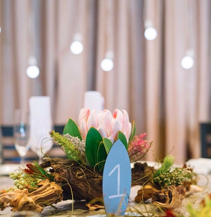 If you're using driftwood on your tables make sure they can rest evenly on the table.   No one wants their bubbly to be knocked over!