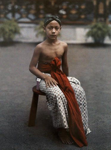 A young actor poses on a stool. W. ROBERT MOORE/National Geographic Creative