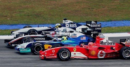 Four abreast - Michael Schumacher (Ferrari), Felipe Massa (Sauber), Juan Pablo Montoya (McLaren) and Nick Heidfeld (Williams)