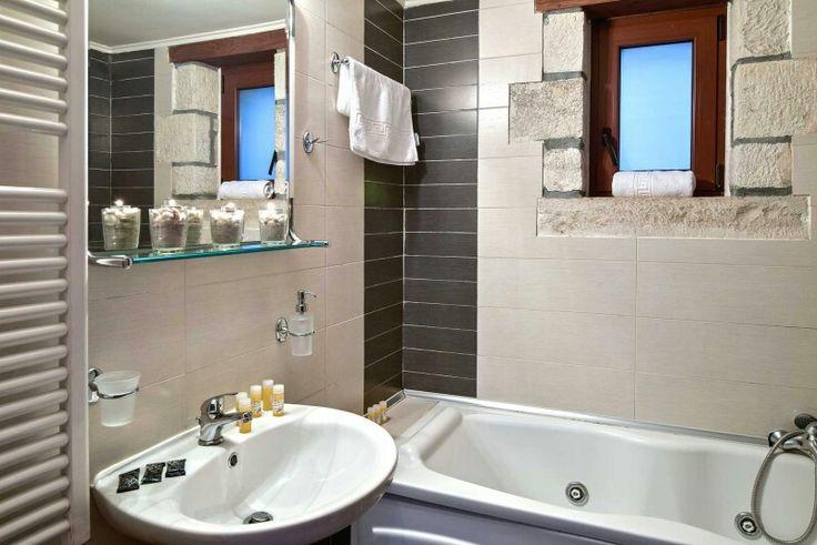 A bathroom with jacuzzi bathtub!