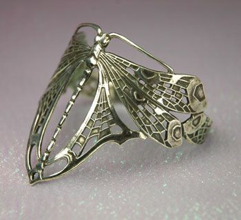 Stunning dragonfly ring in Art Nouveau styling.  and Oh wow, I have the bracelet of this and have never seen it anywhere else :)