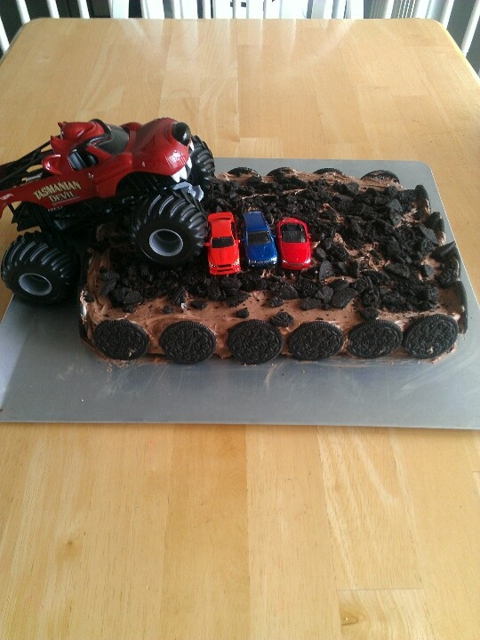 Easy Monster Jam birthday cake: box mix birthday cake, icing, Oreos, cars and a monster truck.