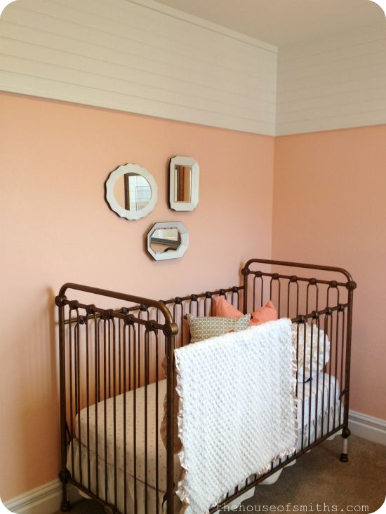 love the planked walls above. vintage baby nursery - peach gold and white - brass metal crib