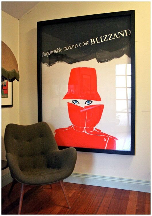 Audrey Hephburn Poster Eyes  L'impermeable moderne c'est Blizzand (Red Raincoat for Audrey Hepburn) poster by Rene Gruau (1965)  The space has changed since the photo was taken but she remains. She's my girl. love her.