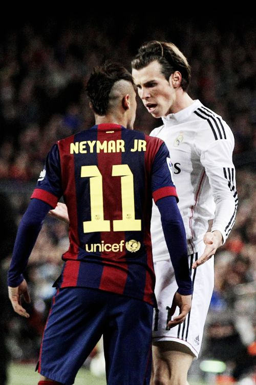 """Barcelona's Neymar argues with Real Madrid's Gareth Bale during a Spanish La Liga soccer match between FC Barcelona and Real Madrid at Camp Nou stadium, in Barcelona, Spain, Sunday, March 22, 2015."""