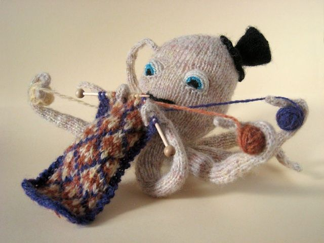 He wears a top hat and knits.  He may be the coolest octopus ever. <3