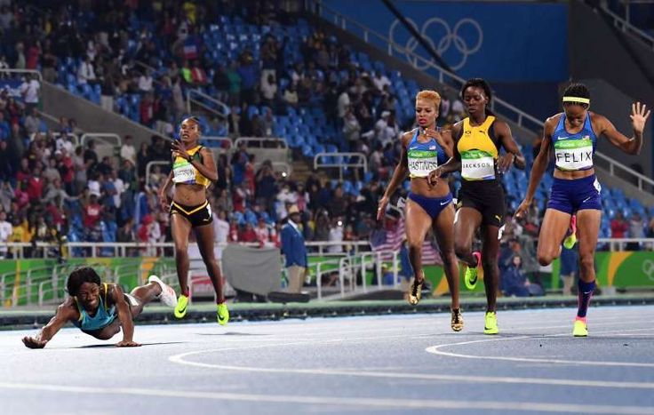 The best sports pictures of 2016:      Shaunae Miller of the Bahamas ﴾L﴿ dives across the finish line ahead of Shericka Jackson of Jamaica and Natasha Hastings and Allyson Felix of the United States to win the women's 400 meter final at the Rio 2016 Olympic Games on Aug. 15.