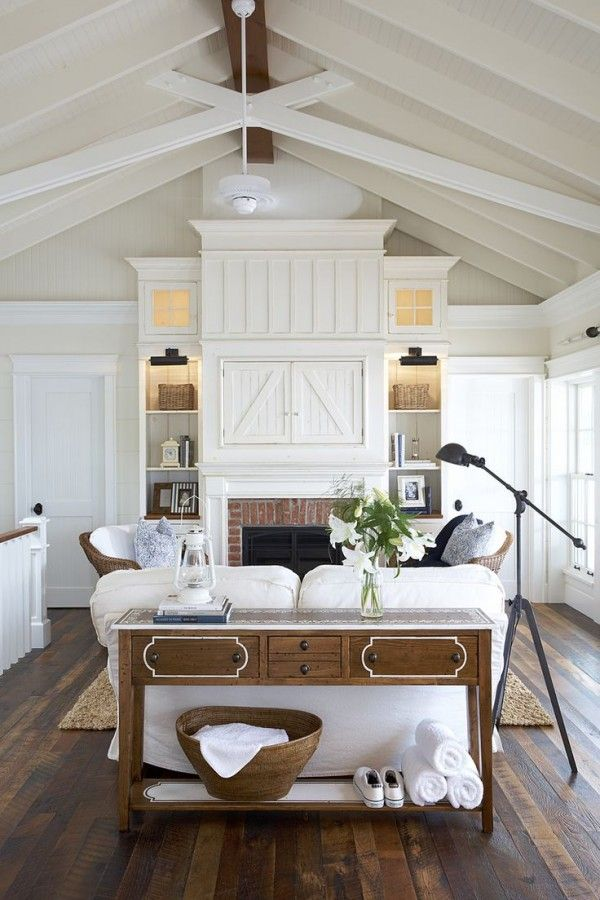 So many things to love: contrast dark floor with white walls; stark white tripm with an off white wall color; using wood as an accent; clean spacious room :: family room