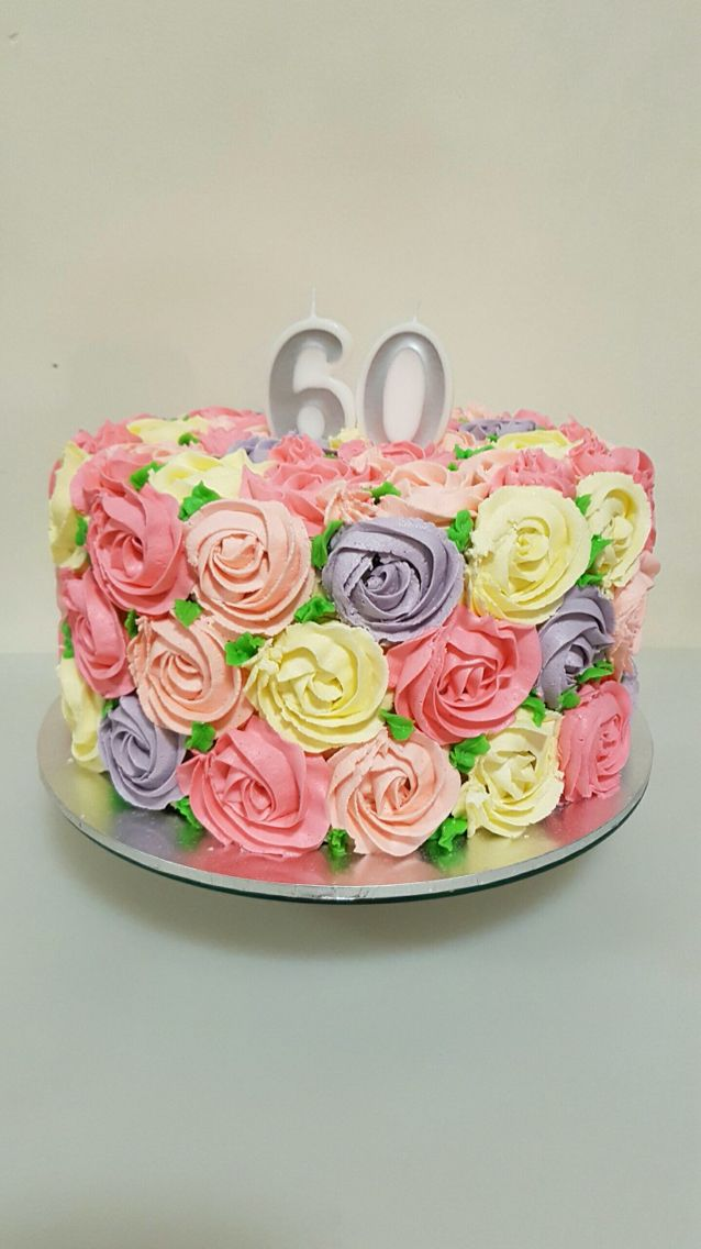Buttercream rosette cake. Multicoloured rosettes with leaves for MIL 60th birthday cake. Rose cake