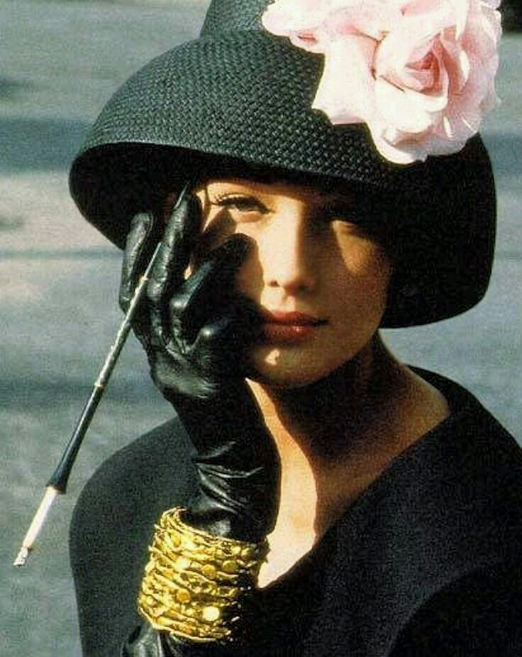 Carla Bruni in a sweet little lampshade hat.