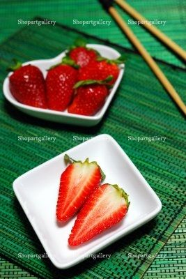 Portion Of Fresh Strawberries by Alessio Orrù  FEATURED AT SHOPARTGALLERY.COM (week 11-18 february 2013)  Just click on it and see all the places where you can purchase this photo, or prints and gadgets from Zazzle, Fine Art America or Cafepress!