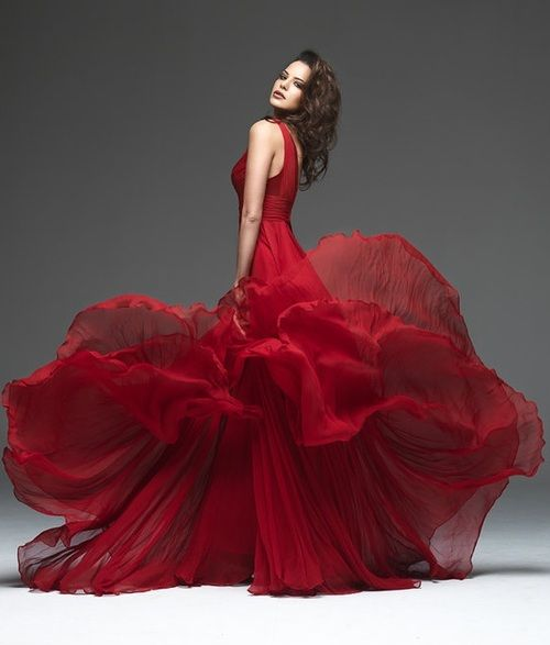 ordinarily, a red dress like this wears its person, this beautiful person…