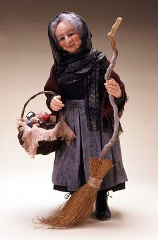 La Befana the Christmas witch, said to walk or fly about Italy on her broom putting gifts in stockings or giving presents on Epiphany eve, January 5th, looking for the Christ child or her own or keeping watch over all children. She may be related to the Sabine/Roman Goddess Strenua who gave out New Years gifts