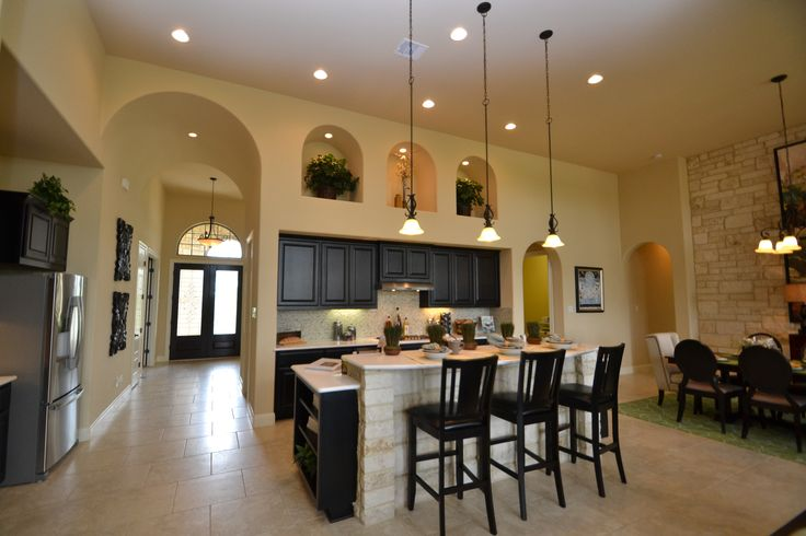 High ceilings with warm charm in this lovely kitchen.