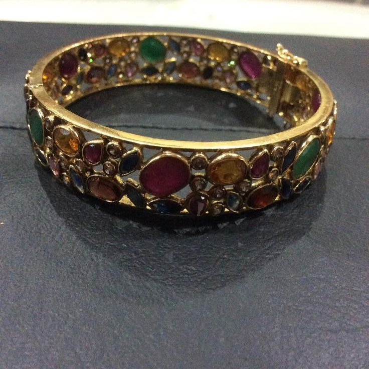 """Multicolour (mogok) stone bangle set in 22k gold.#jewellery #banglebracelet #classstyle#mogok #beautifulbangle #myburma #mydubai #londonmilanparisnewyork…"""